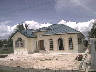 Front of home in Chaguanas. Designed by the Architect.